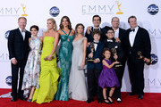 (L-R) Actors Jesse Tyler Ferguson, Ariel Winter, Julie Bowen, Sofia Vergara, Sarah Hyland, Ty Burrell, Nolan Gould, Ed O'Neill, Rico Rodridgez, and Eric Stonestreet, with Aubrey Anderson-Emmons (front), pose in the press room during the 64th Annual Primetime Emmy Awards at Nokia Theatre L.A. Live on September 23, 2012 in Los Angeles, California.