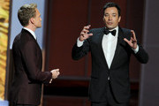 Host Neil Patrick Harris and Jimmy Fallon speak onstage during the 65th Annual Primetime Emmy Awards held at Nokia Theatre L.A. Live on September 22, 2013 in Los Angeles, California.