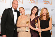 """(L-R) Director Michael Sucsy, actress Drew Barrymore, executive producer Lucy Barzun Donnelly and producer Rachael Horovitz, winners of the Best Mini-Series or Motion Picture Made for Television for """"Grey Gardens"""" pose in the press room at the 67th Annual Golden Globe Awards held at The Beverly Hilton Hotel on January 17, 2010 in Beverly Hills, California."""