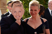 Actor Ricky Gervais (L, behind Ellen Degeneres mask) and Jane Fallon attends the 67th Annual Primetime Emmy Awards at Microsoft Theater on September 20, 2015 in Los Angeles, California.
