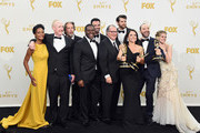 """(L-R) Actors Sufe Bradshaw, Matt Walsh, Gary Cole, Sam Richardson, Reid Scott, Kevin Dunn, Timothy Simons, Julia Louis-Dreyfus, Tony Hale and Anna Chlumsky, winners of Outstanding Comedy Series for """"Veep"""", pose in the press room at the 67th Annual Primetime Emmy Awards at Microsoft Theater on September 20, 2015 in Los Angeles, California."""