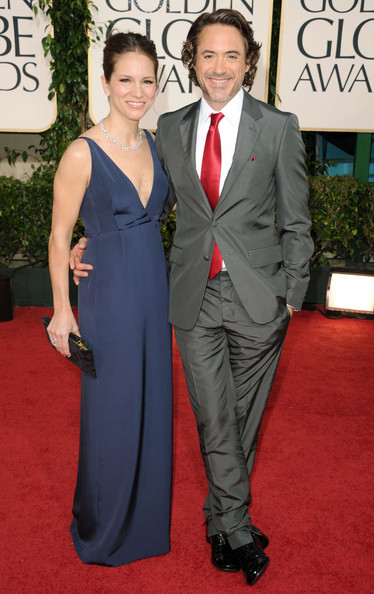 Actor Robert Downey Jr. (R) and producer Susan Downey arrive at the 68th Annual Golden Globe Awards held at The Beverly Hilton hotel on January 16, 2011 in Beverly Hills, California.