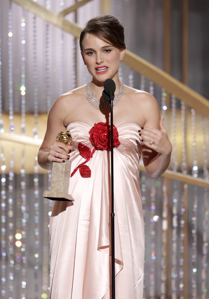 "In this handout photo provided by NBC, Actress Natalie Portman accepts the award for Best Actress in a Motion Picture Drama for ""Black Swan"" onstage during the Golden Globes at the Beverly Hilton International Ballroom on January 16, 2011 in Beverly Hills, California."