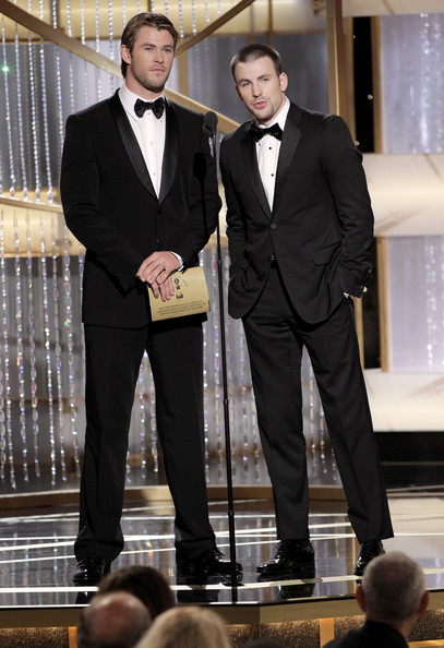 In this handout photo provided by NBC, Presenters Chris Hemsworth (L) and Chris Evans speak onstage during the Golden Globes at the Beverly Hilton International Ballroom on January 16, 2011 in Beverly Hills, California.