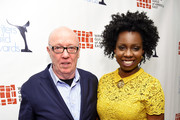 Terry George and Adepero Oduye pose backstage during the 68th Annual Writers Guild Awards at Edison Ballroom on February 13, 2016 in New York City.