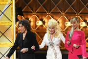 (L-R) Actors Lily Tomlin, Dolly Parton and Jane Fonda walk onstage during the 69th Annual Primetime Emmy Awards at Microsoft Theater on September 17, 2017 in Los Angeles, California.