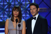 Rashida Jones (L) and Mark Feuerstein present onstage during the 69th Emmy Awards at the Microsoft Theatre on September 17, 2017 in Los Angeles, California. / AFP PHOTO / Frederic J. Brown