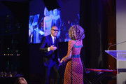 Gucci CEO Marco Bizzarri (L) and poet Cleo Wade attend speak onstage during the 70th Annual Parsons Benefit on May 21, 2018 in New York City.