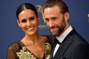 Maria Dolores Dieguez (L) and Joseph Fiennes  attends the 70t Emmy Awards at Microsoft Theater on September 17, 2018 in Los Angeles, California.
