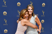 Hoda Kotb (L) and Savannah Guthrie attend the 70th Emmy Awards at Microsoft Theater on September 17, 2018 in Los Angeles, California.