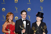 Outstanding Comedy Series winners Sheila Lawrence, Daniel Palladino, and Amy Sherman-Palladino pose in the press room during the 70th Emmy Awards at Microsoft Theater on September 17, 2018 in Los Angeles, California.