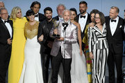 Ryan Murphy (C) and cast and crew accepts the Outstanding Limited Series award for 'The Assassination of Gianni Versace: American Crime Story' onstage during the 70th Emmy Awards at Microsoft Theater on September 17, 2018 in Los Angeles, California.