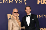 Ryan Murphy (L) and David Miller attend the 71st Emmy Awards at Microsoft Theater on September 22, 2019 in Los Angeles, California.