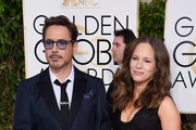 Actor Robert Downey, Jr. and producer Susan Downey attend the 72nd Annual Golden Globe Awards at The Beverly Hilton Hotel on January 11, 2015 in Beverly Hills, California.