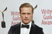 Sam Heughan poses backstage at the 72nd Writers Guild Awards at Edison Ballroom on February 01, 2020 in New York City.