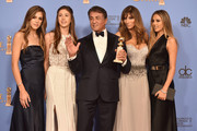 Actor Sylvester Stallone (C),  winner of Best Supporting Performance in a Motion Picture for 'Creed,' poses in the press room with wife Jennifer Flavin (2nd R) and daughters Sistine, Sophia and Scarlet during the 73rd Annual Golden Globe Awards held at the Beverly Hilton Hotel on January 10, 2016 in Beverly Hills, California.
