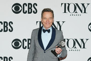 """Bryan Cranston, winner of the award for  Best Performance by an Actor in a Leading Role in a Play for """"Network,"""" poses in the press room for the 73rd Annual Tony Awards at 3 West Club on June 9, 2019 in New York City."""