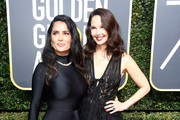 Actors Salma Hayek (L) and Ashley Judd attend The 75th Annual Golden Globe Awards at The Beverly Hilton Hotel on January 7, 2018 in Beverly Hills, California.
