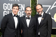 (L-R) Producers Peter Spears and Marco Morabito and director Luca Guadagnino attend The 75th Annual Golden Globe Awards at The Beverly Hilton Hotel on January 7, 2018 in Beverly Hills, California.