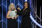In this handout photo provided by NBCUniversal, Presenters Amy Poehler and Maya Rudolph  speak onstage during the 76th Annual Golden Globe Awards at The Beverly Hilton Hotel on January 06, 2019 in Beverly Hills, California.