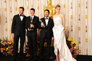 Composers Atticus Ross (2nd L) and Trent Reznor (2nd R, winners of the award for Best Original Score for 'The Social Network', and presenters Hugh Jackman (L) and Nicole Kidman pose in the press room during the 83rd Annual Academy Awards held at the Kodak Theatre on February 27, 2011 in Hollywood, California.
