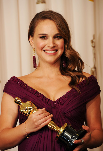 Actress Natalie Portman (R), winner of the award for Best Actress in a Leading Role for 'Black Swan', poses in the press room during the 83rd Annual Academy Awards held at the Kodak Theatre on February 27, 2011 in Hollywood, California.