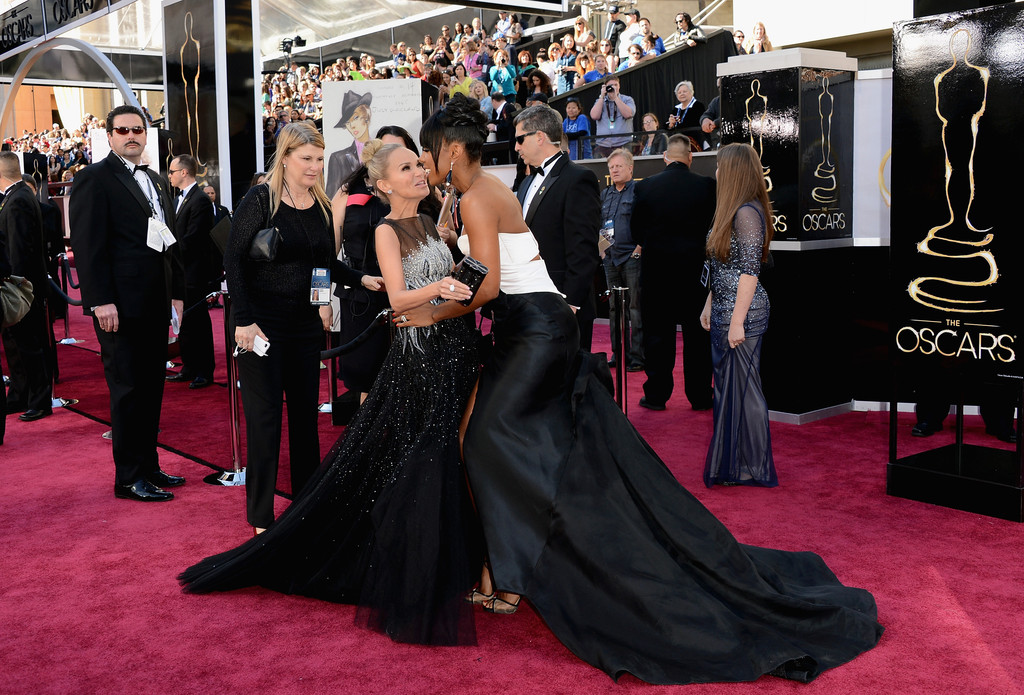 Actress-singer Kristin Chenoweth (L) and singer Kelly Rowland attend the Oscars at Hollywood & Highland Center on February 24, 2013 in Hollywood, California.