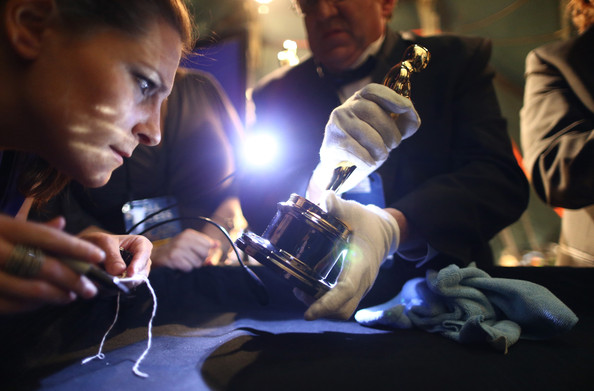 12 Pictures of People Poking, Prodding, Inspecting, Polishing, and Generally Making a Fuss Over Oscar Statues