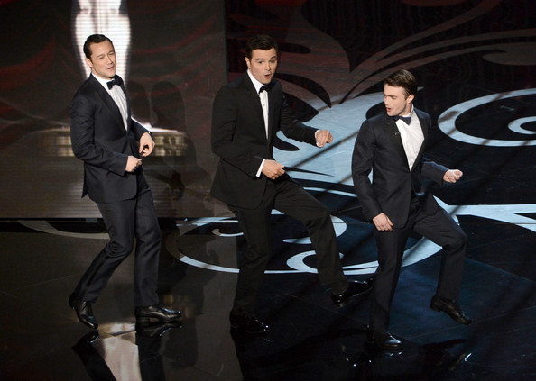 Actor Joseph Gordon-Levitt, host Seth MacFarlane and actor Daniel Radcliffe dance onstage during the Oscars held at the Dolby Theatre on February 24, 2013 in Hollywood, California.