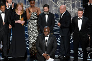 Director Steve McQueen (C) accepts the Best Picture award for '12 Years a Slave' with (back row) actor Chiwetel Ejiofor, Adepero Oduye, producers Anthony Katagas, Arnon Milchan and Brad Pitt onstage during the Oscars at the Dolby Theatre on March 2, 2014 in Hollywood, California.