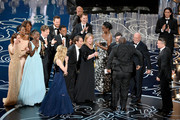 Director Steve McQueen (5R) celebrates the Best Picture award for '12 Years a Slave' with (back row) actors Sarah Paulson, Benedict Cumberbatch, Lupita Nyong'o, screenwriter John Ridley, actor Chiwetel Ejiofor, producers Arnon Milchan, Dede Gardner, Jeremy Kleiner and Anthony Katagas, actress Adepero Oduye and producer Brad Pitt onstage during the Oscars at the Dolby Theatre on March 2, 2014 in Hollywood, California.
