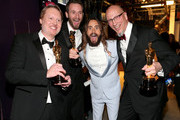 (L-R) Don Hall, Roy Conli, winners of the Best Animated Feature Award for 'Big Hero 6', actor Jared Leto, and Chris Williams, winner of the Best Animated Feature Award for 'Big Hero 6' attends the 87th Annual Academy Awards at Dolby Theatre on February 22, 2015 in Hollywood, California.