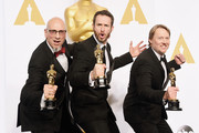 (L-R) Chris Williams, Roy Conli, and Don Hall, winners of the Best Animated Feature Award for 'Big Hero 6', pose in the press room during the 87th Annual Academy Awards at Loews Hollywood Hotel on February 22, 2015 in Hollywood, California.