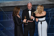 "Frances Hannon and Mark Coulier accept the Best Makeup & Hairstyling Award for ""The Grand Budapest Hotel"" from Reese Witherspoon onstage during the 87th Annual Academy Awards at Dolby Theatre on February 22, 2015 in Hollywood, California."