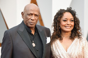 Actor Louis Gossett Jr. (R) and Candy Brown attend the 88th Annual Academy Awards at Hollywood & Highland Center on February 28, 2016 in Hollywood, California.