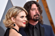 Musician Dave Grohl (R) and Jordyn Blum attend the 88th Annual Academy Awards at Hollywood & Highland Center on February 28, 2016 in Hollywood, California.