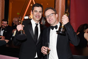 Josh Singer (R) and Tom McCarthy, winners of the award for Best Original Screenplay for 'Spotlight,' attend the 88th Annual Academy Awards Governors Ball at Hollywood & Highland Center on February 28, 2016 in Hollywood, California.
