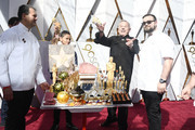 Wolfgang Puck (2nd from R) attends the 90th Annual Academy Awards at Hollywood & Highland Center on March 4, 2018 in Hollywood, California.