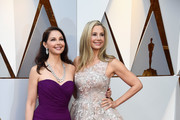 Ashley Judd (L) and Mira Sorvino attend the 90th Annual Academy Awards at Hollywood & Highland Center on March 4, 2018 in Hollywood, California.