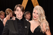 Megan Ellison and Drew Denny (R) attend the 90th Annual Academy Awards at Hollywood & Highland Center on March 4, 2018 in Hollywood, California.