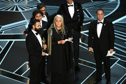 (L-R) Co-director Adrian Molina, actors Anthony Gonzalez, Gael Garcia Bernal and Benjamin Bratt, producer Darla K. Anderson, and director Lee Unkrich accept Best Animated Feature Film for 'Coco' onstage during the 90th Annual Academy Awards at the Dolby Theatre at Hollywood & Highland Center on March 4, 2018 in Hollywood, California.