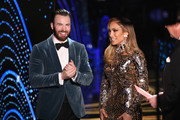 In this handout provided by A.M.P.A.S., Chris Evans and Jennifer Lopez pose backstage during the 91st Annual Academy Awards at the Dolby Theatre on February 24, 2019 in Hollywood, California.
