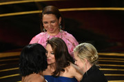 (L-R) Regina King accepts the Actress in a Supporting Role award for 'If Beale Street Could Talk' from Maya Rudolph,  Amy Poehler, and Tina Fey onstage during the 91st Annual Academy Awards at Dolby Theatre on February 24, 2019 in Hollywood, California.