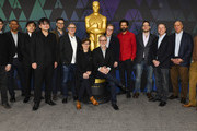 (L-R) Animated Feature Nominees Christopher Miller, Peter Ramsey, Yuichiro Saito, Mamoru Hosoda, Phil Johnston, John Walker, Nicole Paradis Grindle, Rich Moore, Brad Bird, Rodney Rothman, Clark Spencer, Steven Rales, Ben Persichetti, and Phil Lord attend the 91st Oscars - Oscar Week: Animated Features at the Academy of Motion Picture Arts and Sciences on February 23, 2019 in Beverly Hills, California.