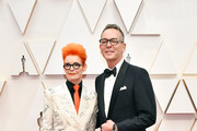 (L-R) Costume designer Sandy Powell and Christopher Peterson attend the 92nd Annual Academy Awards at Hollywood and Highland on February 09, 2020 in Hollywood, California.
