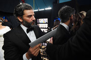 In this handout photo provided by A.M.P.A.S. Oscar Isaac walks backstage during the 92nd Annual Academy Awards at the Dolby Theatre on February 09, 2020 in Hollywood, California.