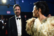 In this handout photo provided by A.M.P.A.S. Ray Romano and Sandra Oh stand backstage during the 92nd Annual Academy Awards at the Dolby Theatre on February 09, 2020 in Hollywood, California.
