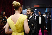 In this handout photo provided by A.M.P.A.S. Oscar Isaac stands backstage during the 92nd Annual Academy Awards at the Dolby Theatre on February 09, 2020 in Hollywood, California.