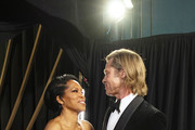In this handout photo provided by A.M.P.A.S. Regina King and Best Actor in a Supporting Role winner Brad Pitt speak backstage during the 92nd Annual Academy Awards at the Dolby Theatre on February 09, 2020 in Hollywood, California.
