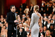 "In this handout photo provided by A.M.P.A.S. Renée Zellweger (R) accepts the Best Actress award for ""Judy"" from Rami Malek (L) onstage during the 92nd Annual Academy Awards at the Dolby Theatre on February 09, 2020 in Hollywood, California."